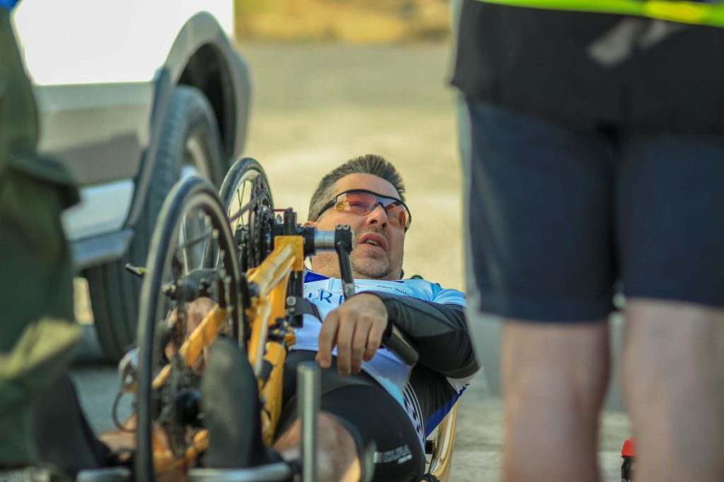 Ken warming up on his handcycle in the desert car park