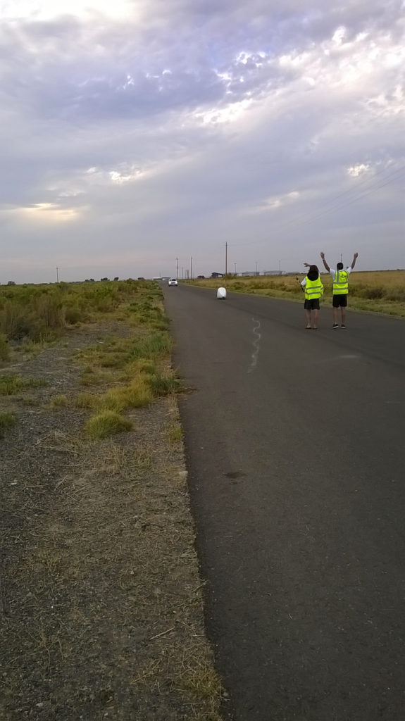 Handcycle riding on road towards catch team