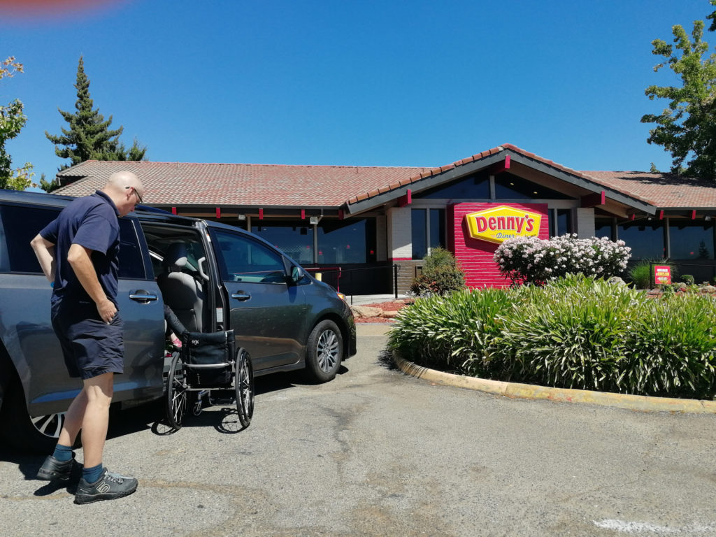 John helping with wheelchairs outside of Denny's restaurant