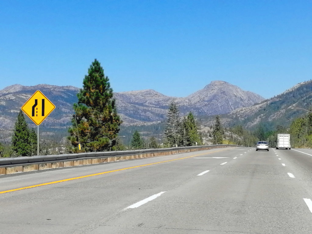 View of mountains in the distance on a freeway