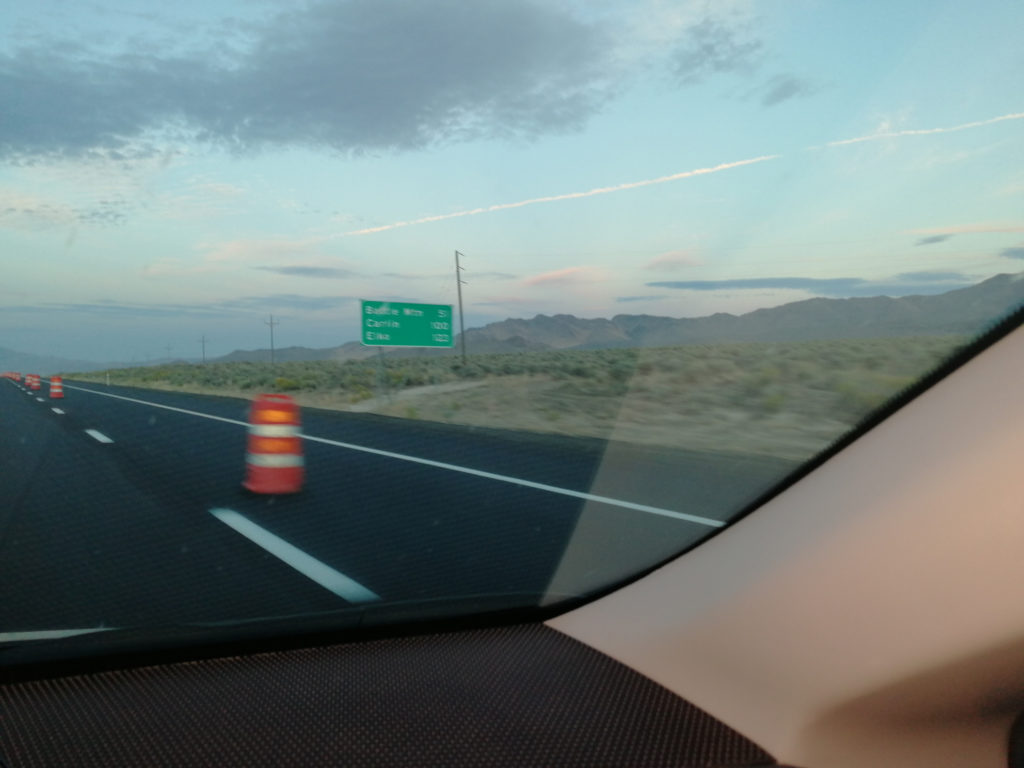View of roadsign to Battle Mountain from a passing car